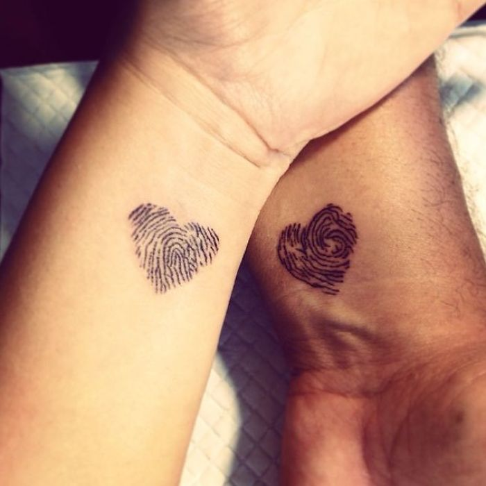 matching tattoos couple fingerprint hearts