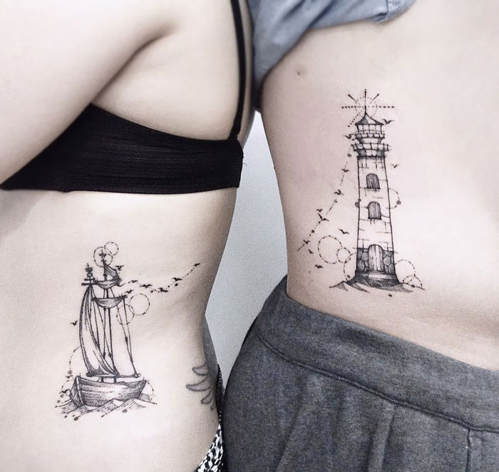 matching tattoos couple lighthouse ship