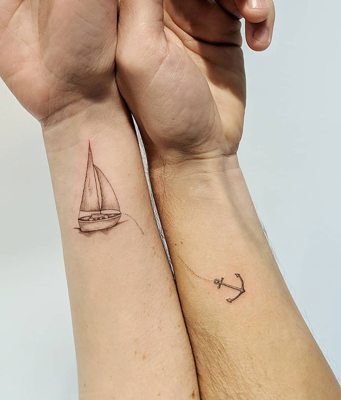 matching tattoos couple ship anchor
