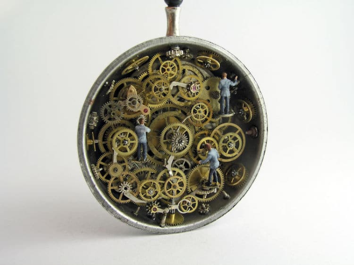 men working in miniature worlds inside pocket watches and pendants