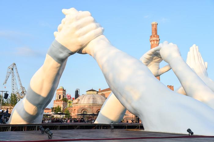monumental hands art installation venice