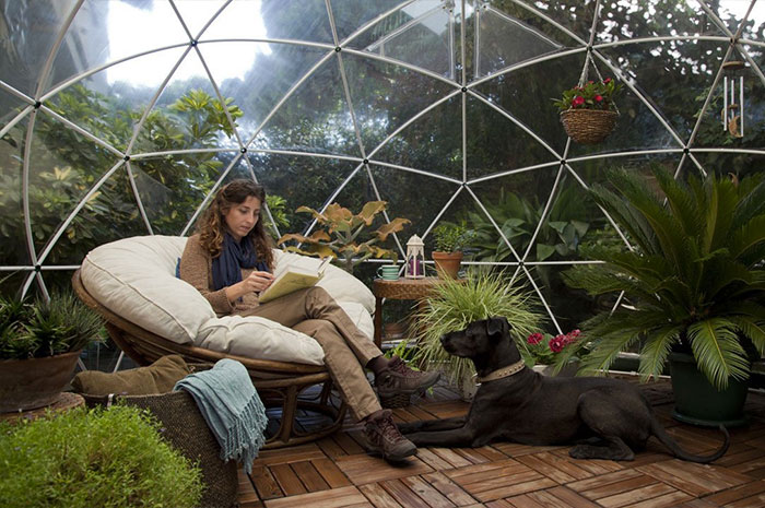readin inside clear greenhouse dome garden igloo