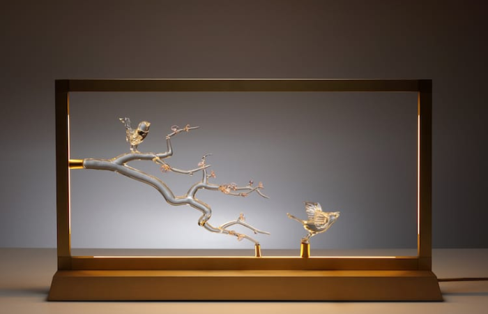 simone crestani blown glass sculptures with bird in frame