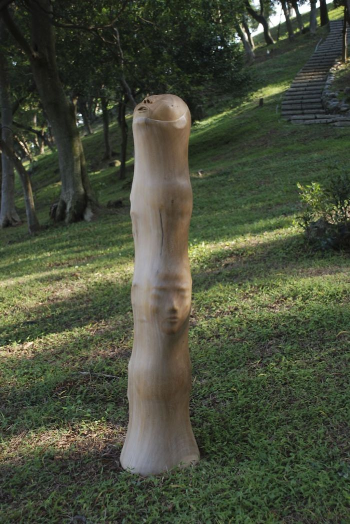 tung ming chin amazing wood sculptures stack of heads