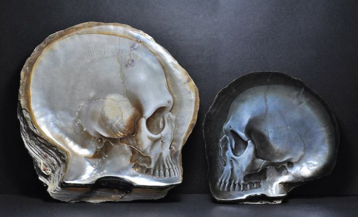 2 skulls face to face gregory halili shell skull carvings
