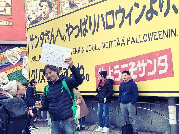 begpacker offering hugs for 100 yen japan