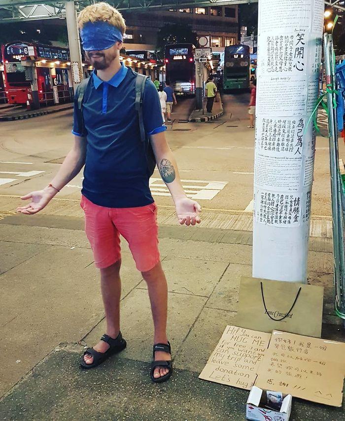 blindfolded begpacker free hugs donation