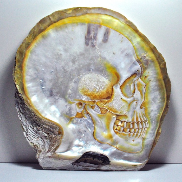 gold sides gregory halili shell skull carvings