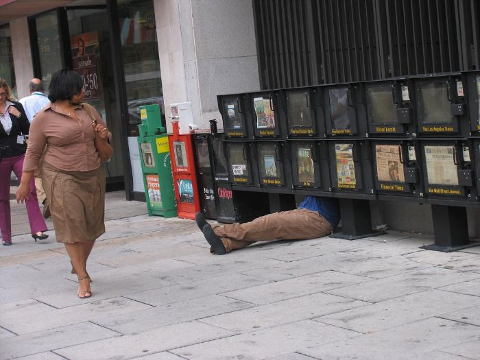 mark jenkins realistic mannequins guy hiding newspaper stand washington dc