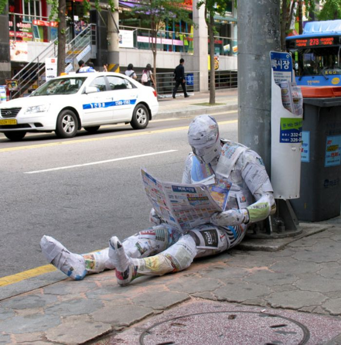 mark jenkins realistic mannequins newspaper guy seoul south korea