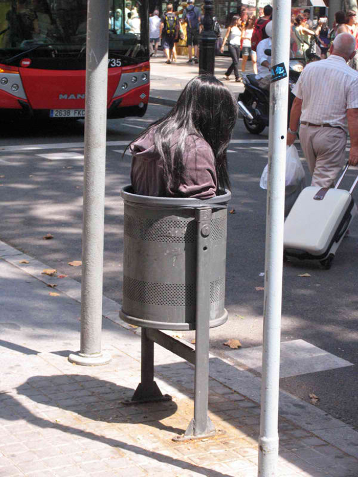 mark jenkins realistic mannequins trash bin girl barcelona spain