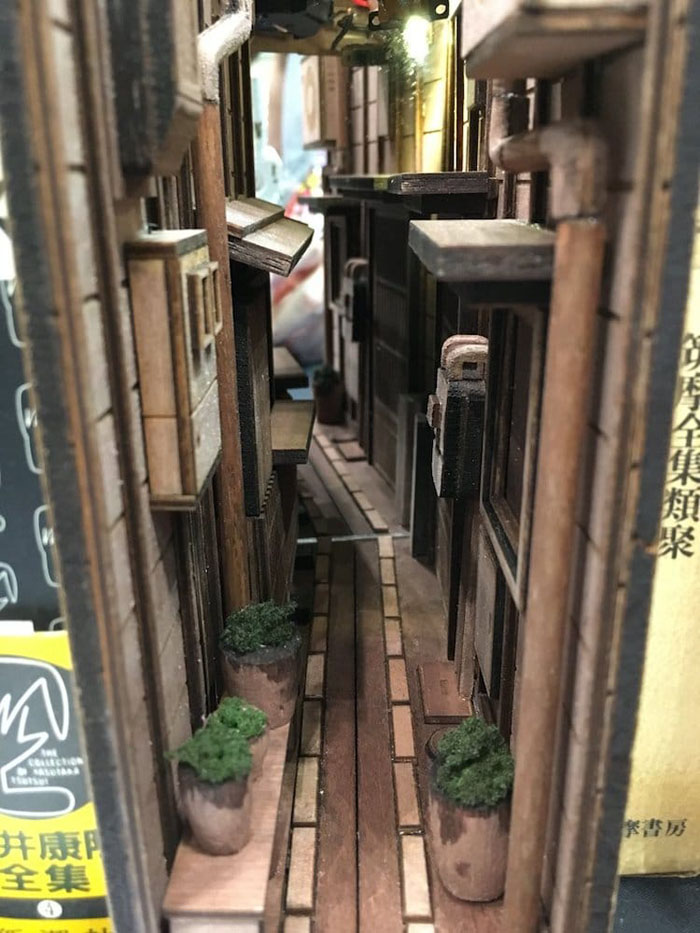 monde back alley bookshelves dioramas