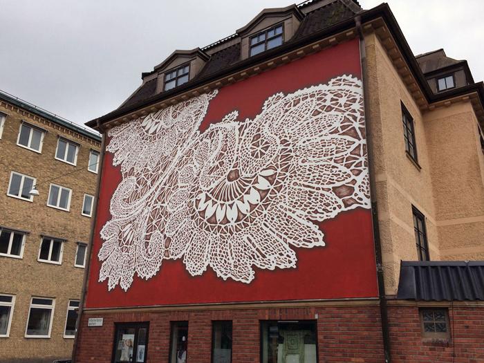 nespoon lacework murals boras sweden red background