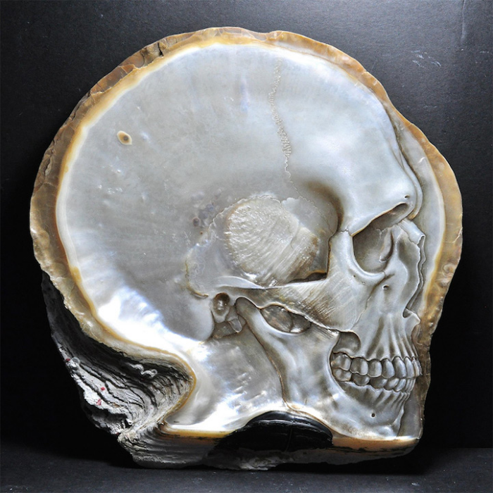 pale colored gregory halili shell skull carvings