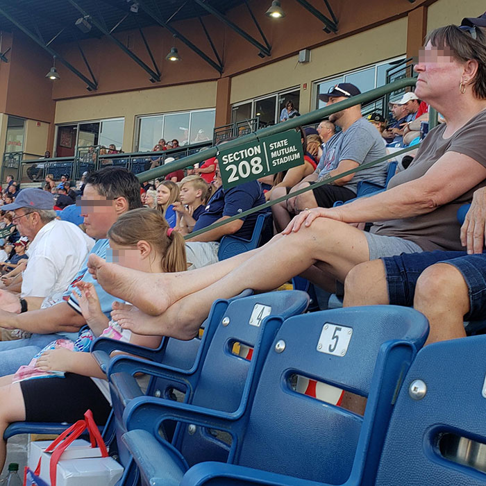 people being jerks feet up baseball game