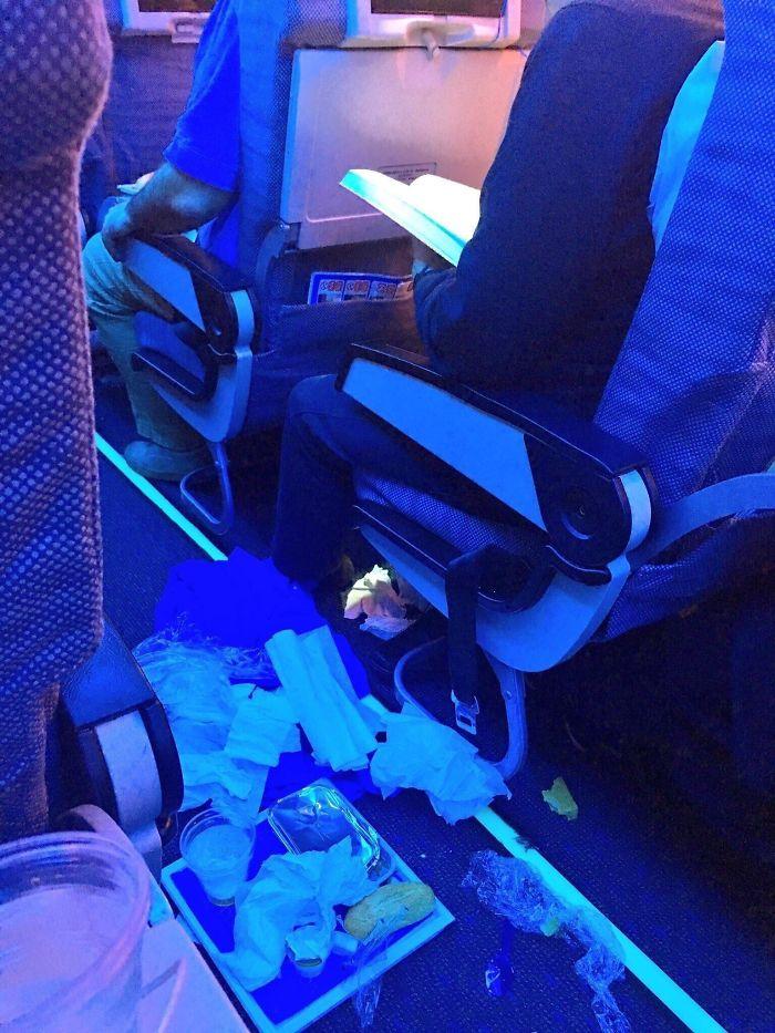people being jerks food garbage airplane aisle