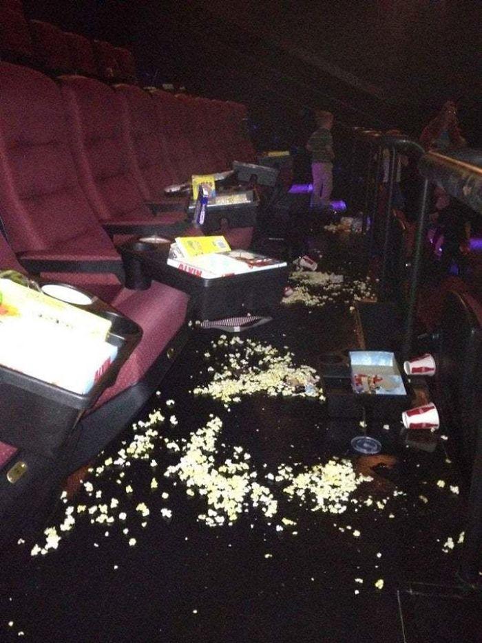 people being jerks littering in cinema