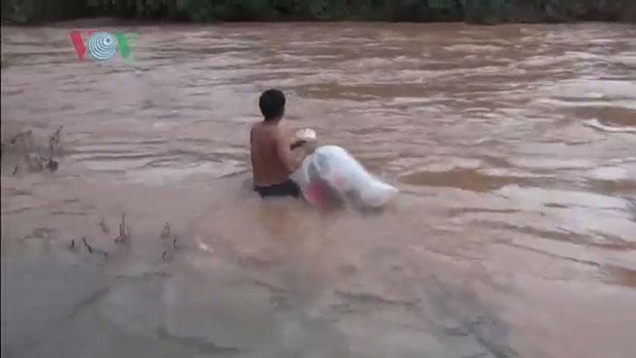 vietnamese schoolkids in plastic bags crossing river