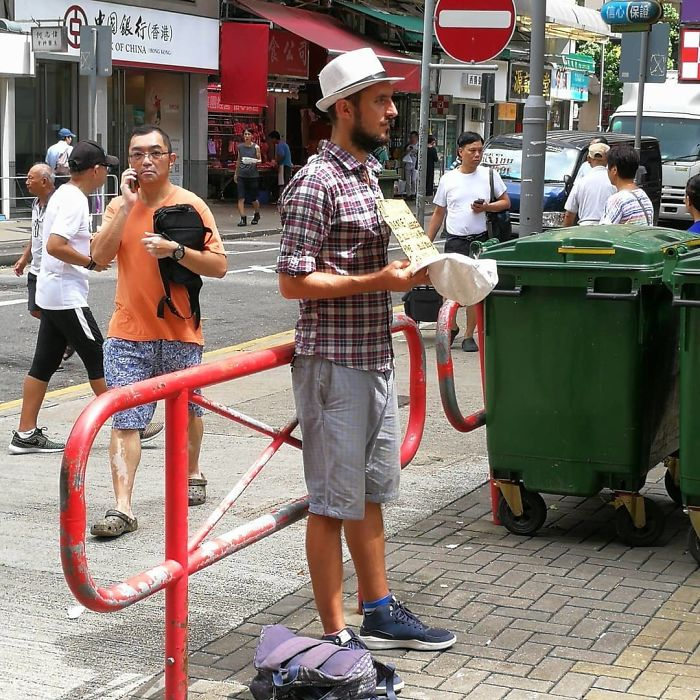 western begpackers wearing new shoes clothes hong kong