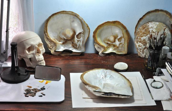 working table gregory halili shell skull carvings