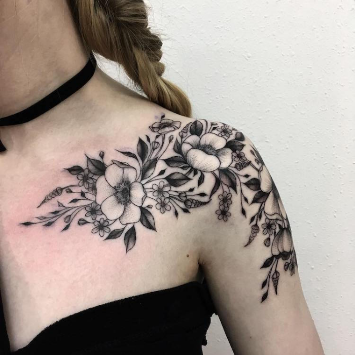 black flower sketches near left shoulders and upper chest best floral tattoo artists