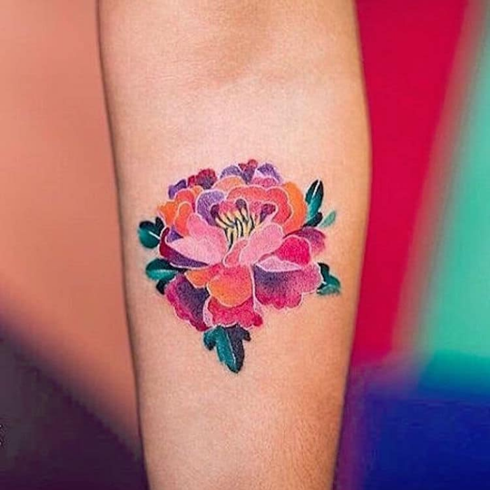 colorful petals lower arm best floral tattoo artists
