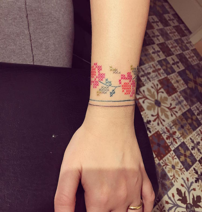cross stitched style flowers wrist best floral tattoo artists