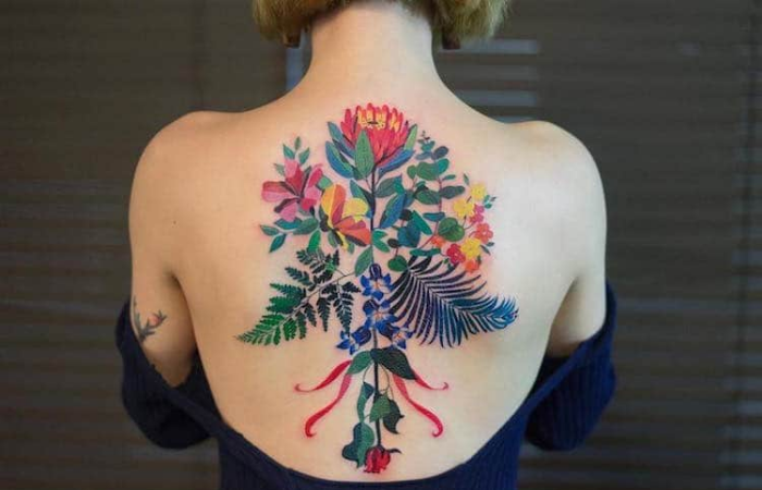 elaborate flowers on back best floral tattoo artists