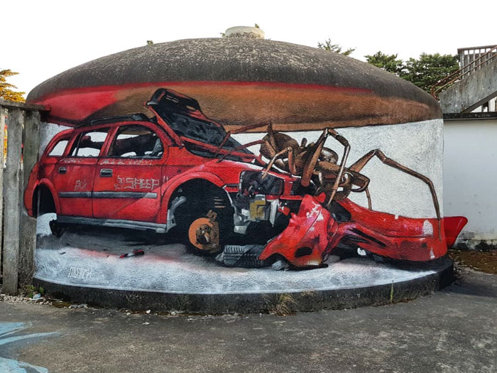 encounter with huge insect red car art graffiti object transformations bus artist odeith