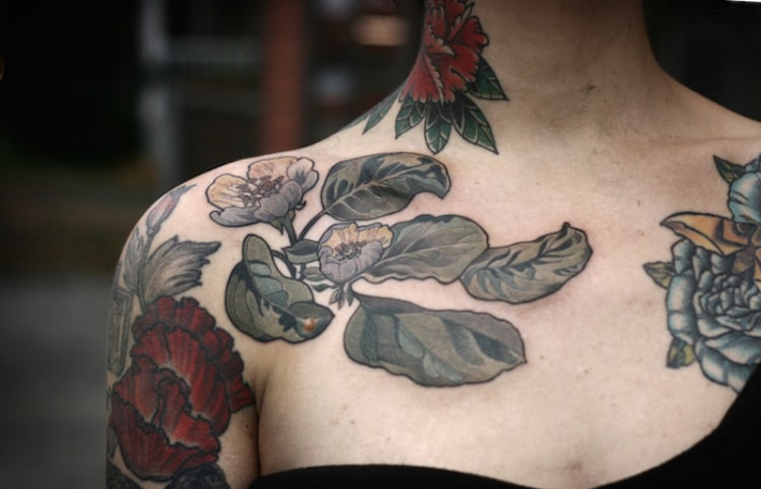 flowers and leaves neck and chest best floral tattoo artists