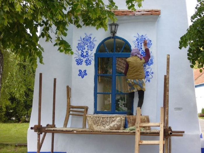 grandma paints houses louka outdoor