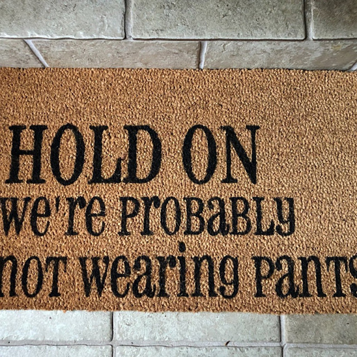hold on we are probably not wearing pants doormat