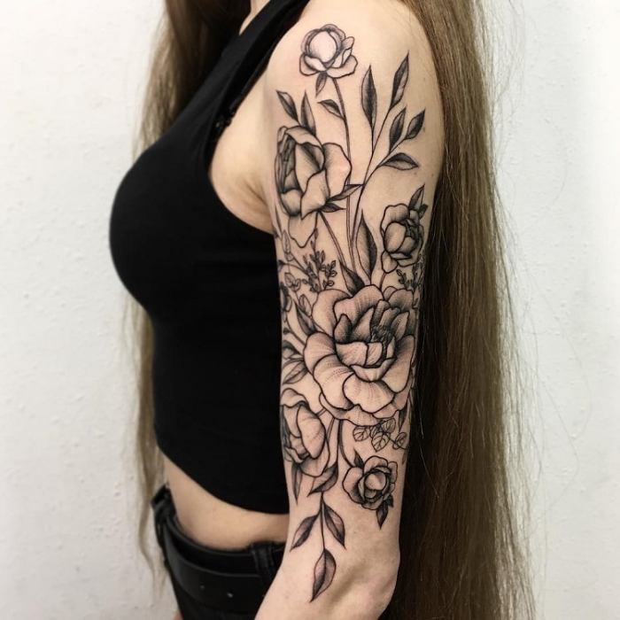 left arm black sketches of flowers best floral tattoo artists