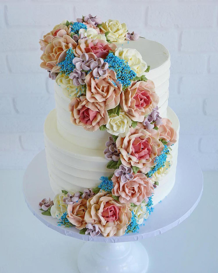 leslie vigil realistic buttercream botanicals two-tiered floral