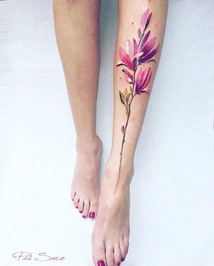 long stem flower on leg best floral tattoo artists