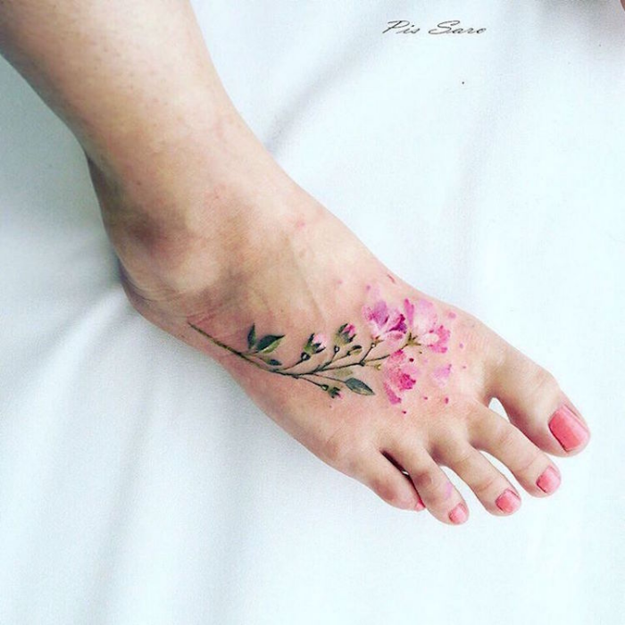 pink flowers on right foot best floral tattoo artists