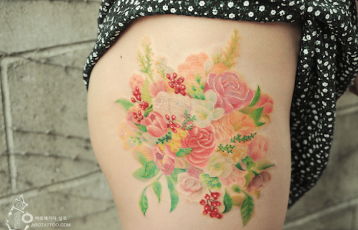 right upper thigh best floral tattoo artists