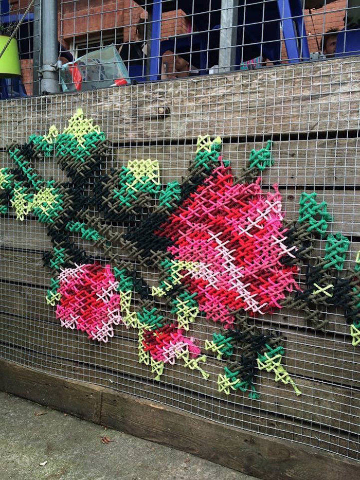 spain floral cross-stitch art installations