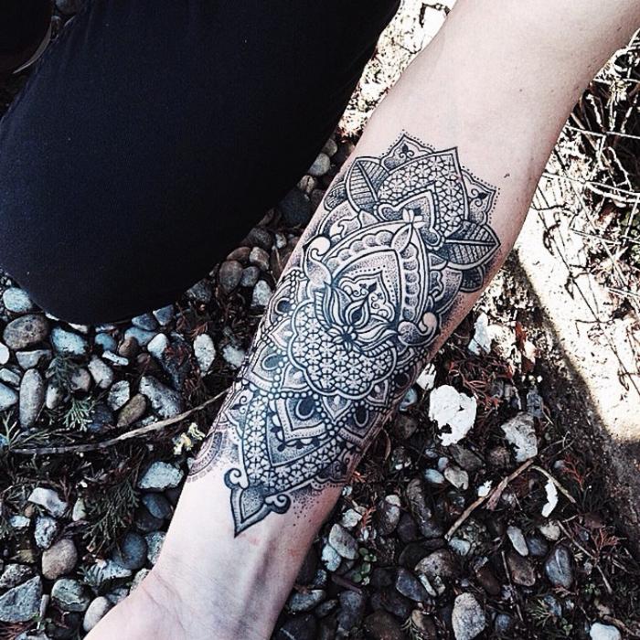 symmetrical design left lower arm best floral tattoo artists