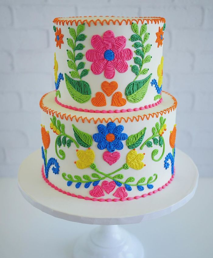 two layered cake with flowers and leaves embroidered patterns in cakes leslie vigil