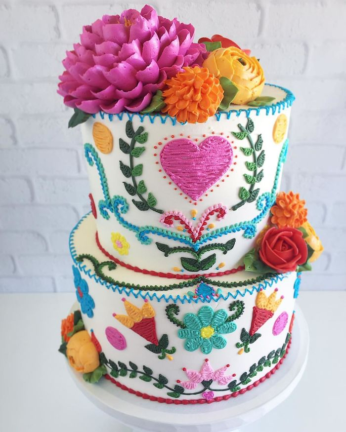 two layered cake with heart embroidered patterns in cakes leslie vigil