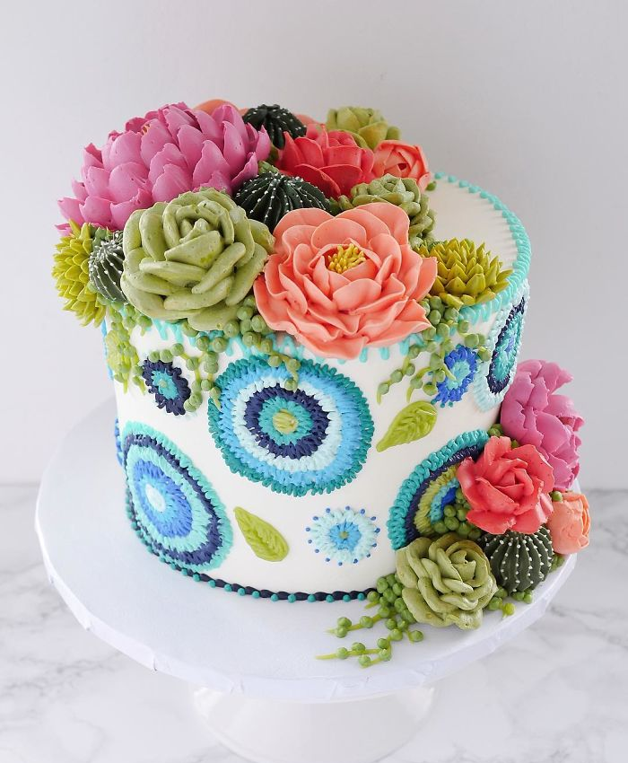 white cake with blue flowers embroidered patterns in cakes leslie vigil