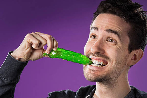 Guy Biting Into Gummy Pickle