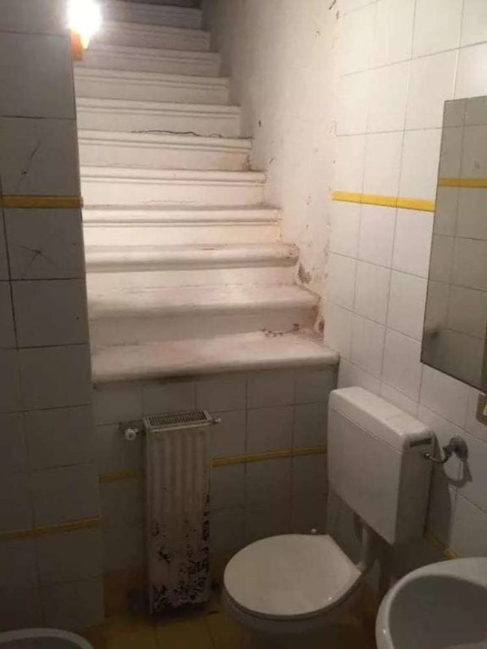 stairs that lead straight into a toilet