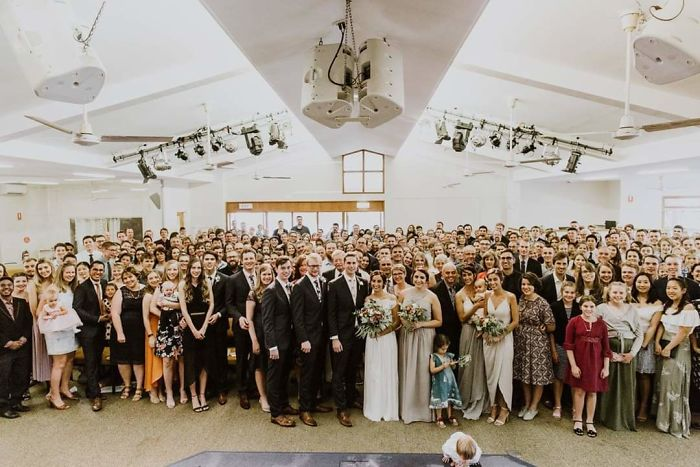 tall people with short people wedding photo