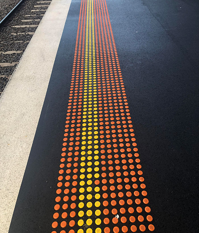 uncomfortable imperfections photos train station orange yellow dots