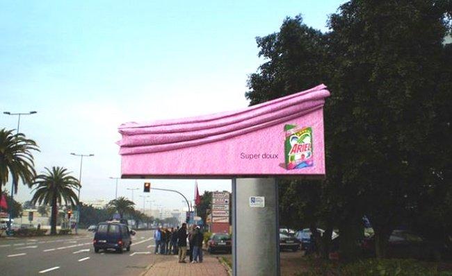Ariel Detergent Advertisement Featuring a Softened Billboard