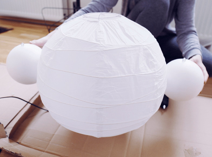 Attaching Two Styrofoam Balls to Both Sides of the Lamp