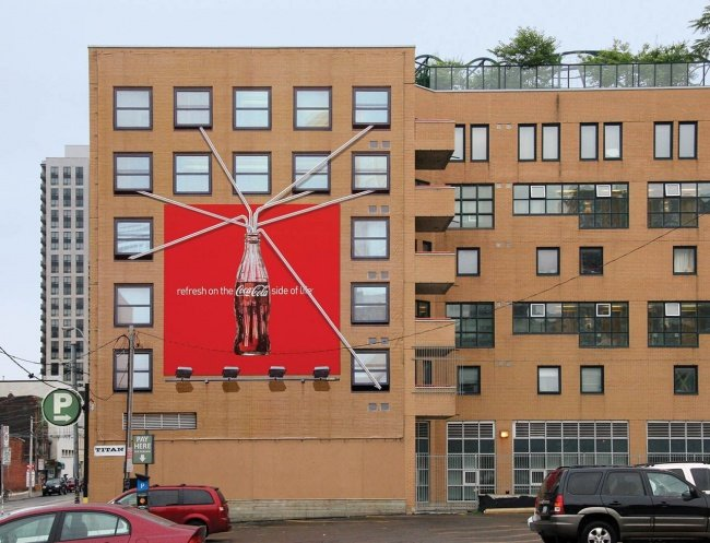 Coca-cola Billboard Featuring Seven Straws Extending Outwards from the Billboard
