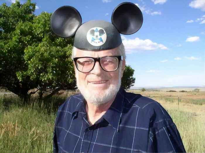 Disneyland's First Ever Customer Dave McPherson Wears Mouse Ears